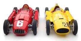 2 vieille voitures de course formule 1 rouge et jaune