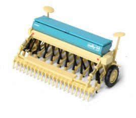 machine agricole vert et beige