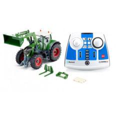 gros tracteur agricole vert avec pelle avant