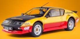 vieille voiture de course noire jaune et rouge