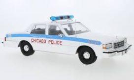 vieille voiture de police blanche et bleu