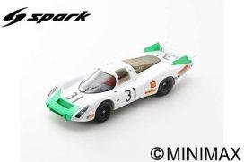 vieille voiture de course blanche et verte