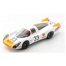 vieille voiture de course blanche et orange